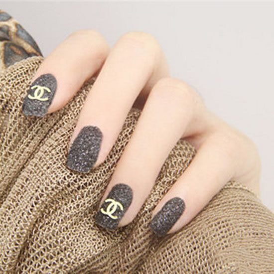 The grey matte manicure with the classic Chanel logo is a low-key and stylish manicure, a classic color scheme.