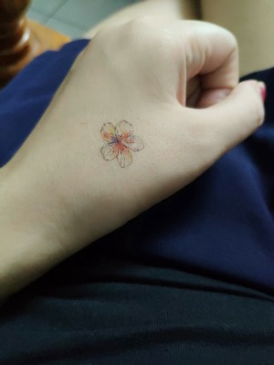 Simple and stylish little tattoo with unique personality